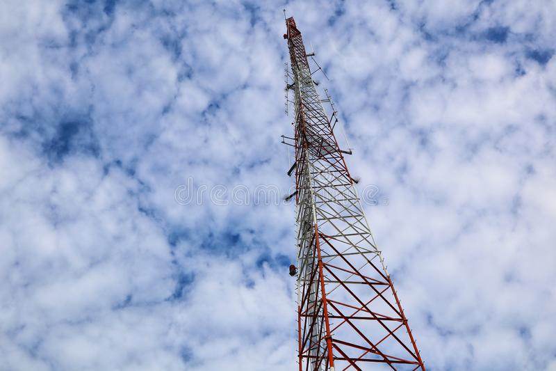 Telecommunication towers, large high-rise steel, sky background and clouds stock photo