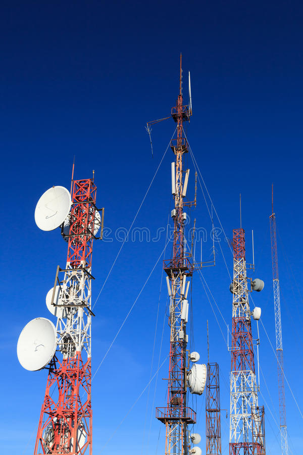 Telecommunication towers with many satellite dishes. Industrial concept stock image