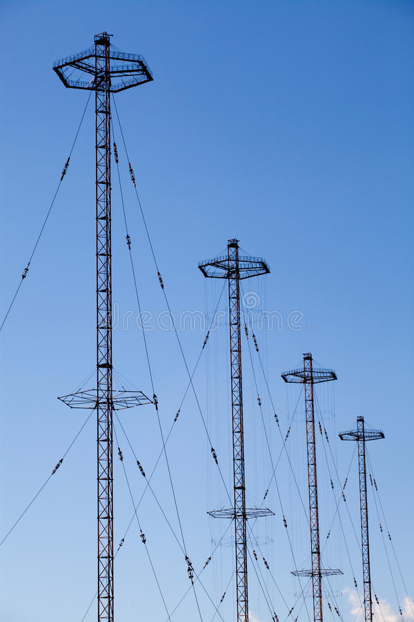 Telecommunication towers. Military telecommunication towers over a blue sky royalty free stock photos