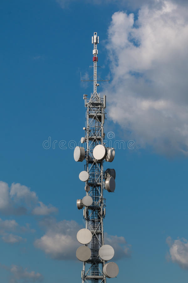 Telecommunication Towers with Satellite Dishes and Antennas stock image