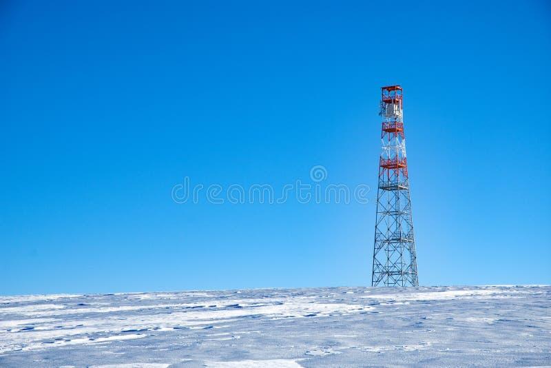 Telecommunication transmitter. Telecommunication masts with blue sky in the background stock photo