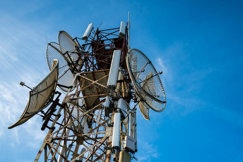 Telecommunications antenna for radio, television and telephone with blue sky.  royalty free stock photos