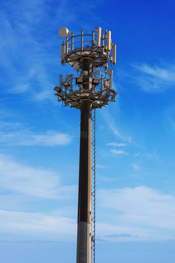 Telecommunication Room Design: Telecommunication Tower On Blue Sky Stock Photo