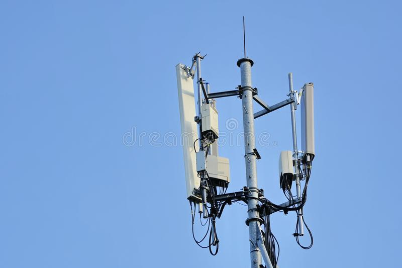 Telecommunications Cell site. 3G, 4G and 5G Cell site, Telecommunication tower, radio tower or mobile phone base station. Development of communication systems in stock image