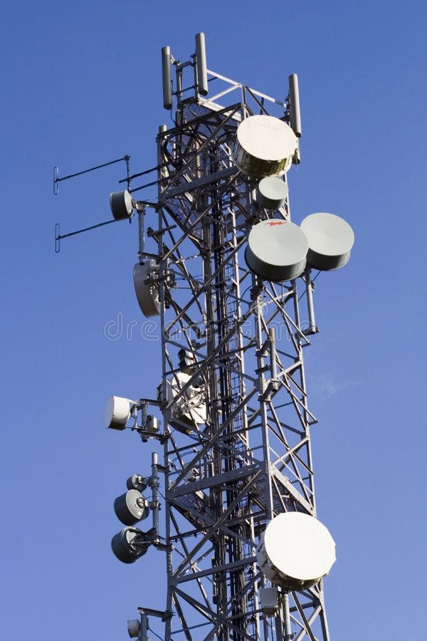Telecommunications mast and blue sky royalty free stock photos