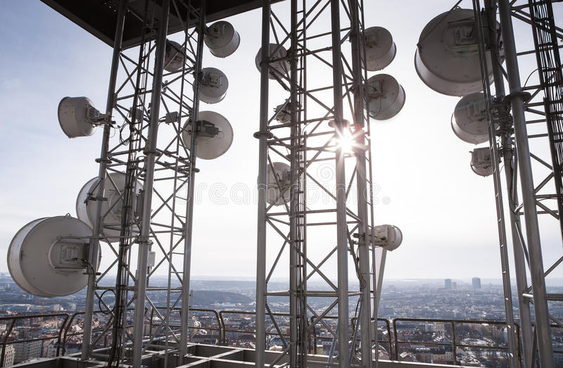 Telecommunications tower. With many satellite dish in the city royalty free stock photography