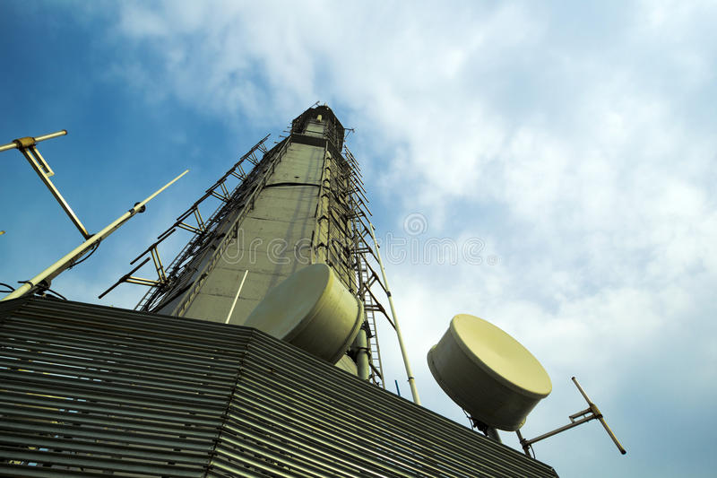 Telecommunications tower xian china. A telecommunications tower against blue sky - dishes detail of XiAn China royalty free stock images