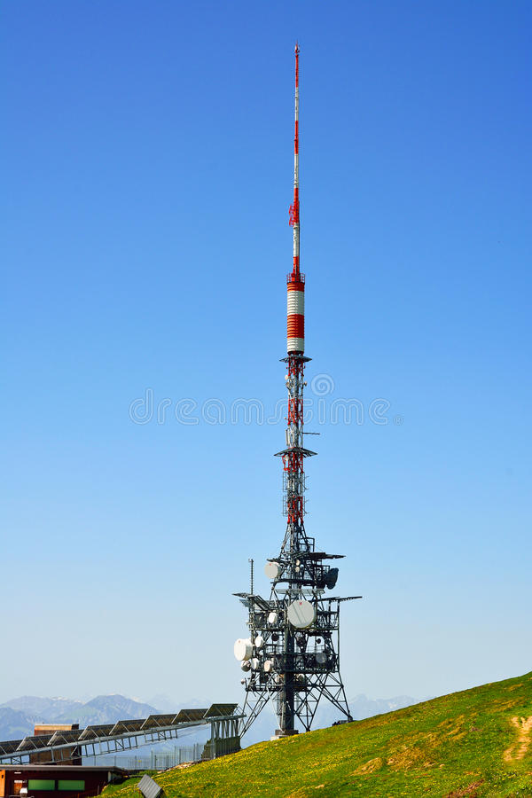 Telecommunications towers. Telecom tower on hight mountain, niederhorn Switzerland royalty free stock photography