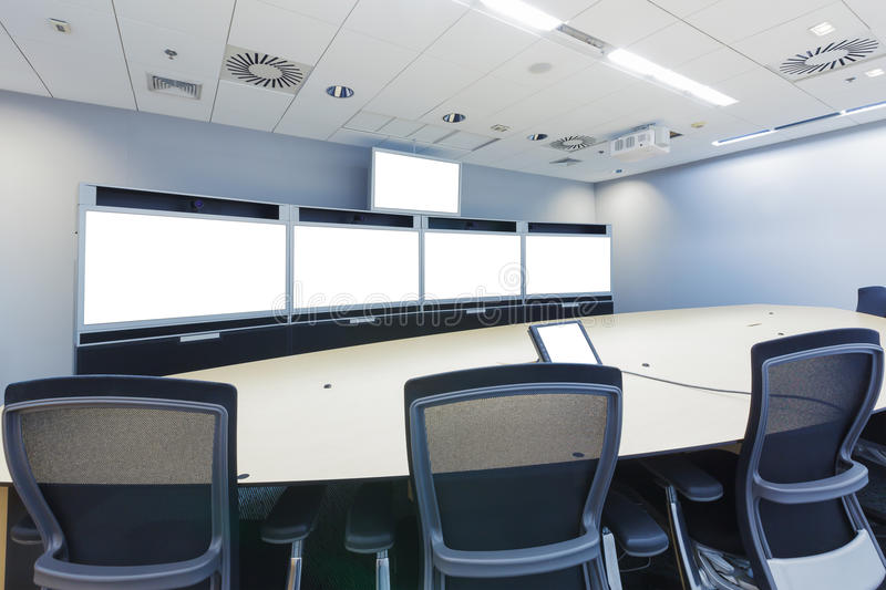 Teleconferencing, video conference and telepresence business meeting room with blank screen display monitor stock images