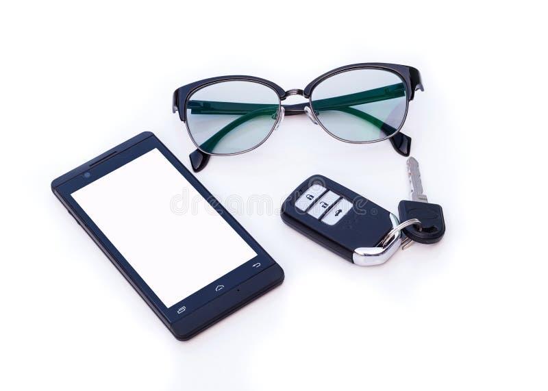 Telecontrol dominante del coche, vidrios del ojo morado, Smartphone, teléfono móvil imagen de archivo
