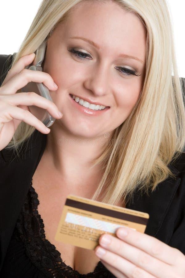 telefon för affärskvinnakortkreditering royaltyfria bilder
