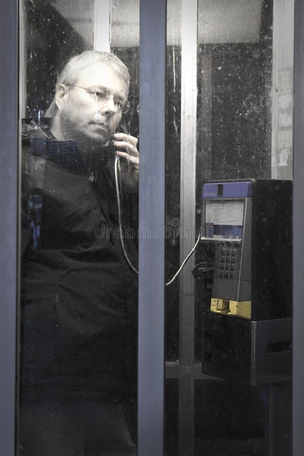 telefon för båsmannatt arkivfoton
