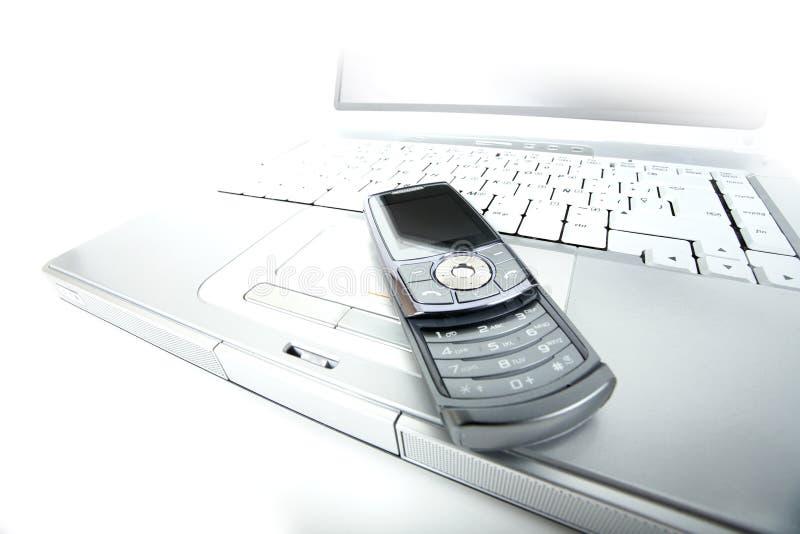 telefon för celldatorbärbar dator arkivfoto
