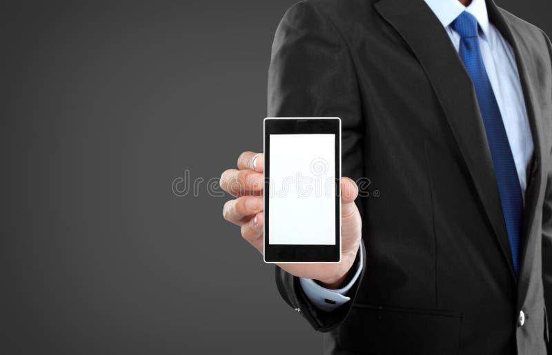 Telefon för hållande mobil för affärsman smart med den tomma skärmen royaltyfri fotografi