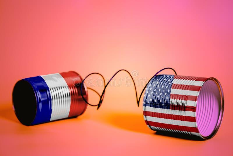 Telefon för tenn- can med USA och Frankrike flaggor svart telefon för kommunikationsbegreppsmottagare arkivbilder