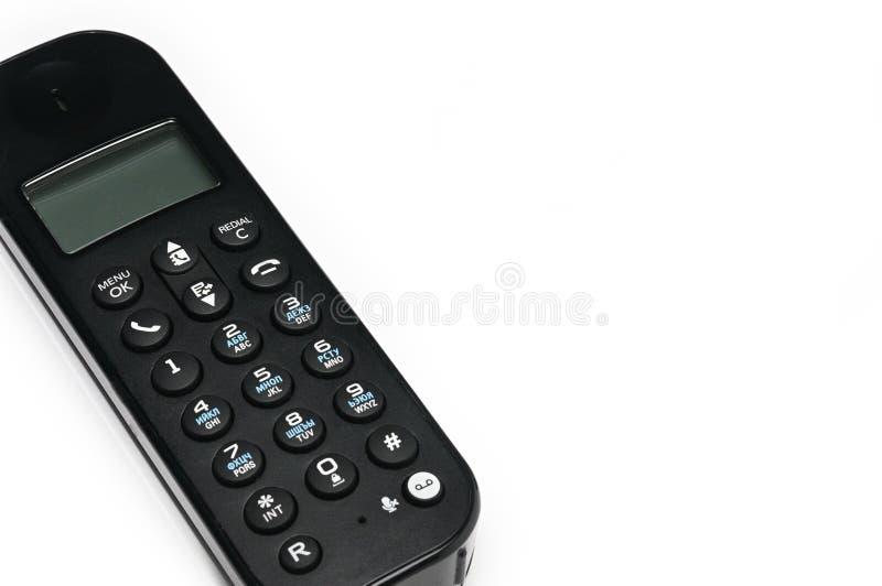 Telefon f?r appeller till stads- och l?ngdistans- linjer p? en vit bakgrund royaltyfria foton