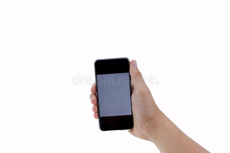 Telefon f?r handinnehavsvart som isoleras p? vit fotografering för bildbyråer