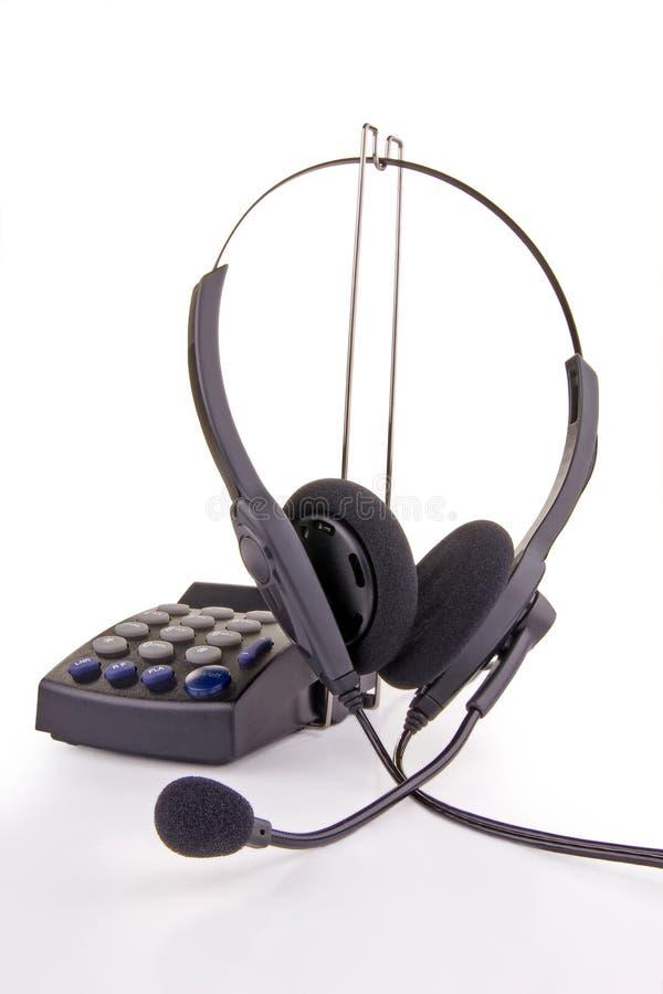 Telefon-Kopfhörer und Tastaturblock lizenzfreies stockbild