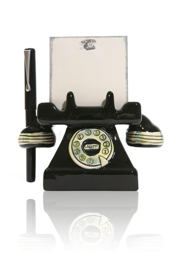 Telefon mit Notizblock und Feder lizenzfreie stockfotos