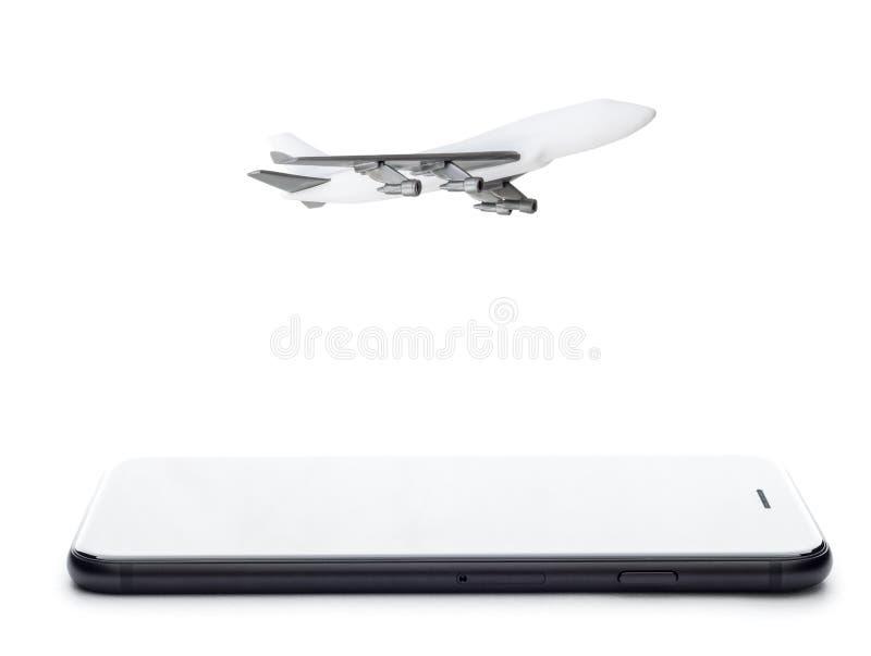 Telefon- och flygplanmodell på vit royaltyfria foton