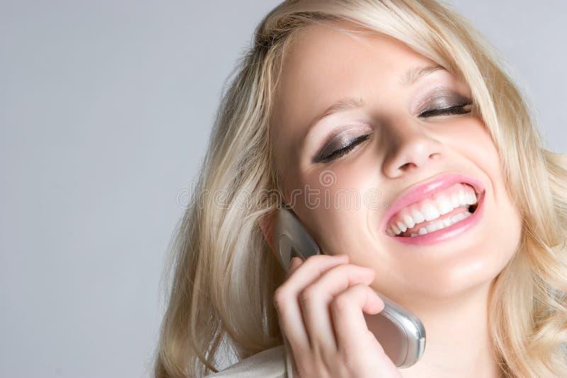 telefon roześmiana kobieta zdjęcia royalty free