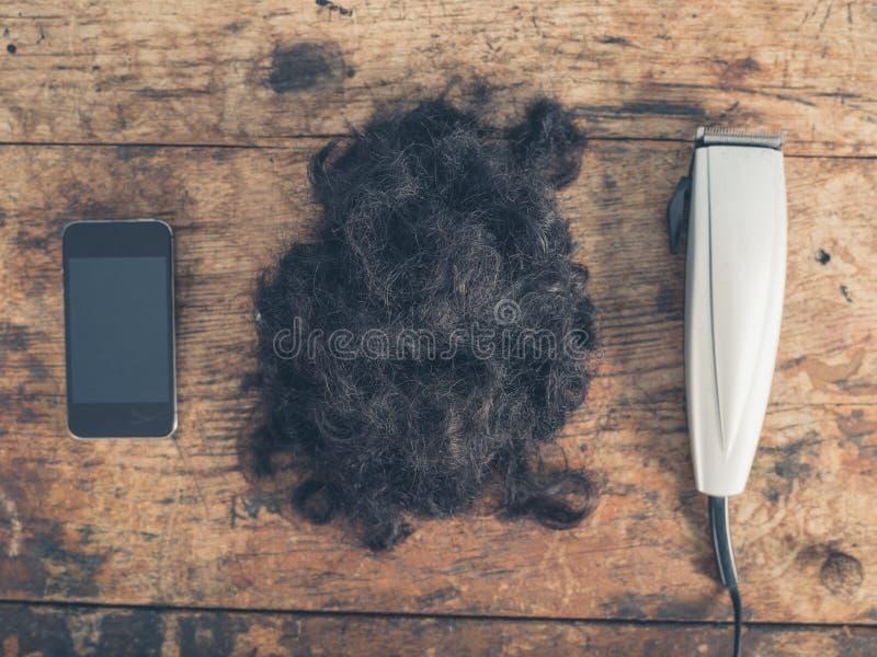 Telefon, włosy i cążki, obrazy stock