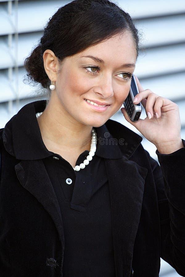 Telefonar da mulher nova fotografia de stock