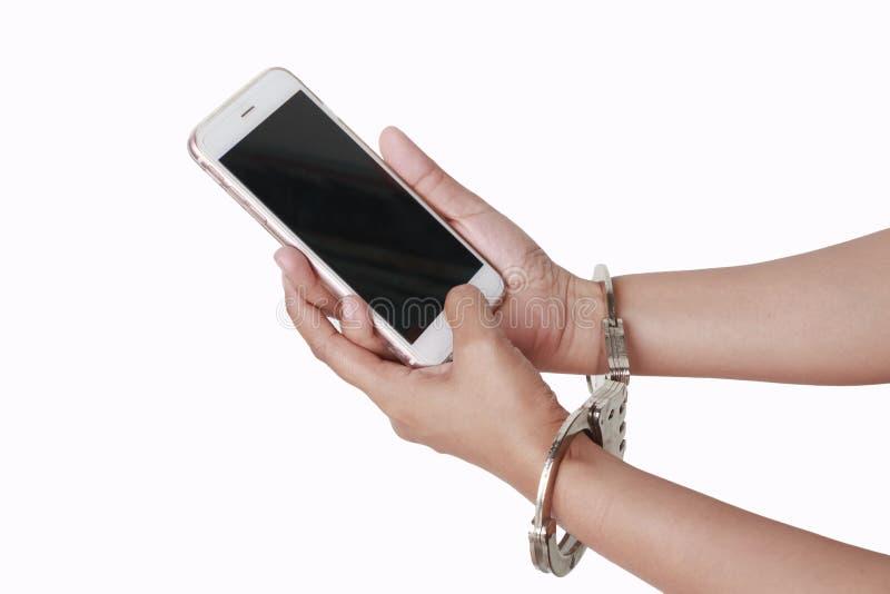 Telefone à disposição com algemas fotografia de stock