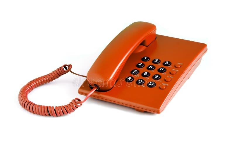 Telefone alaranjado do escritório foto de stock royalty free