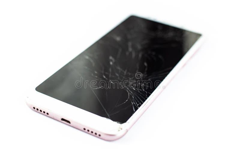Telefone branco com um sensor e uma tela quebrados, vidro rachado do écran sensível em um isolado branco do fundo fotografia de stock