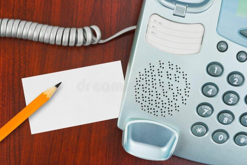 Telefone, cartão de papel e lápis foto de stock royalty free