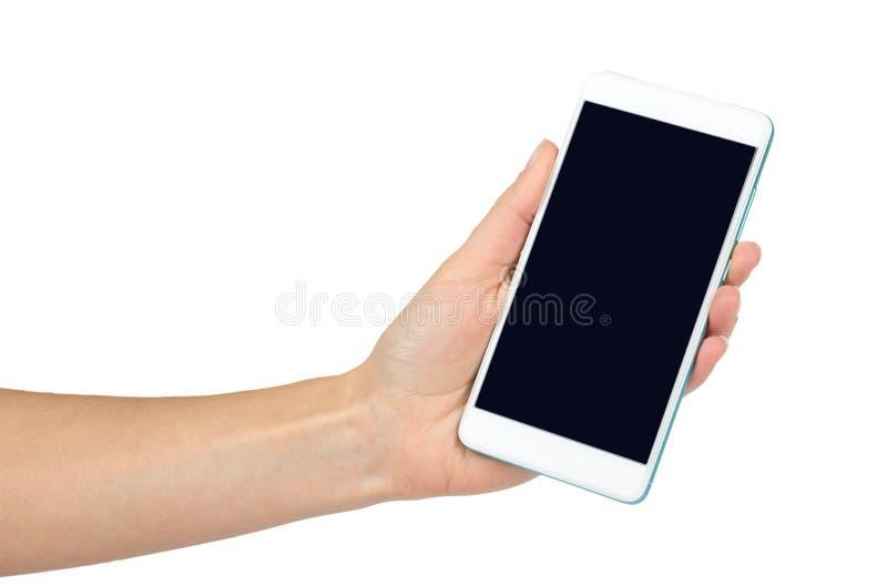 Telefone celular branco com tela escura à disposição, isolado no fundo branco Anuncie o molde, copie o espaço fotografia de stock