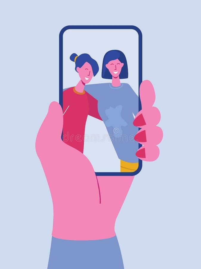 Telefone celular da terra arrendada da mão com as meninas felizes que indicam na tela Amigos que levantam para o selfie, grupo de ilustração royalty free