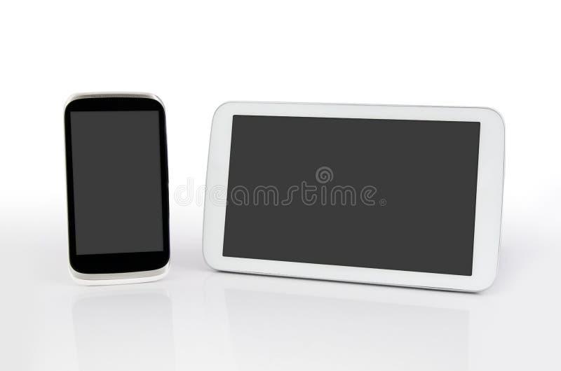 Telefone celular e tabuleta com tela vazia. fotografia de stock