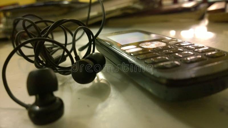 Telefone com auriculares imagem de stock