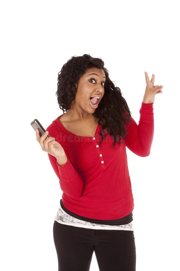 Telefone da mulher do americano africano engraçado imagem de stock