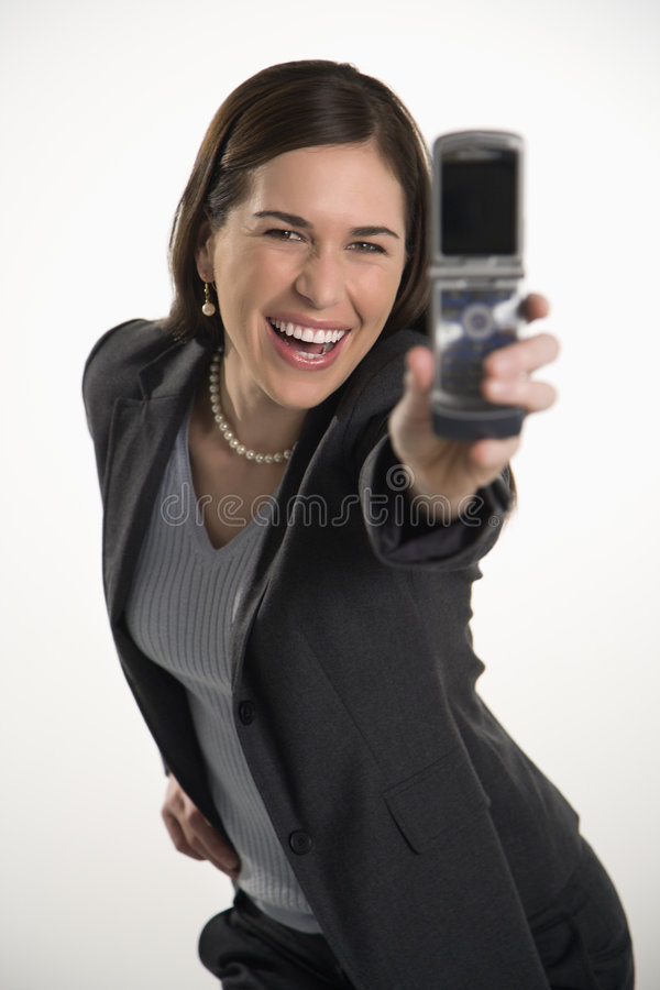 Telefone da mulher e de pilha. foto de stock royalty free