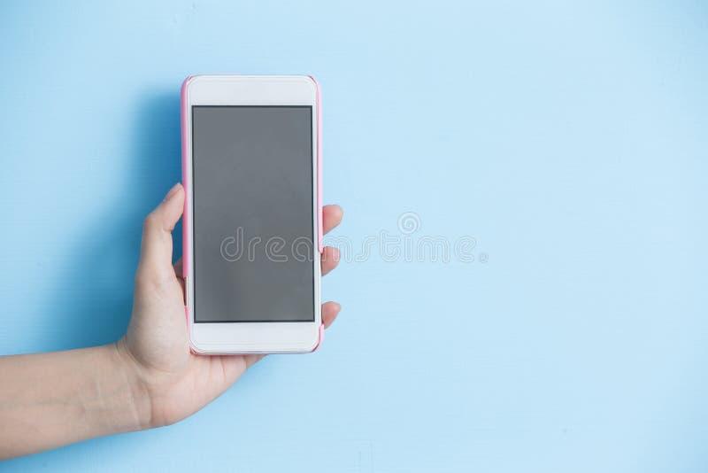 Telefone da tomada da mão imagem de stock