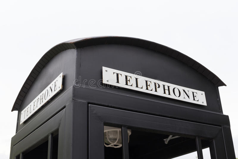 Telefone de pagamento preto grande do vintage foto de stock royalty free