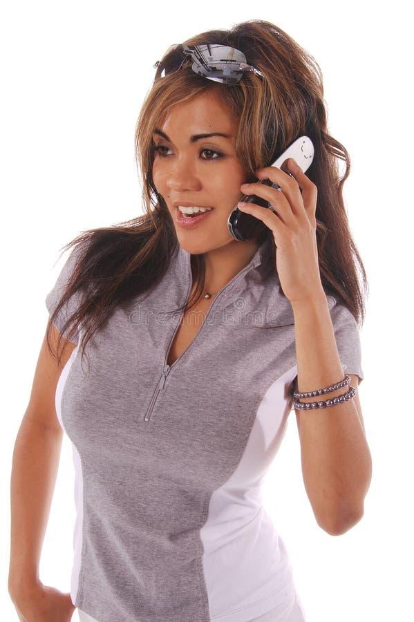 Telefone de pilha 2 da mulher do exercício imagem de stock