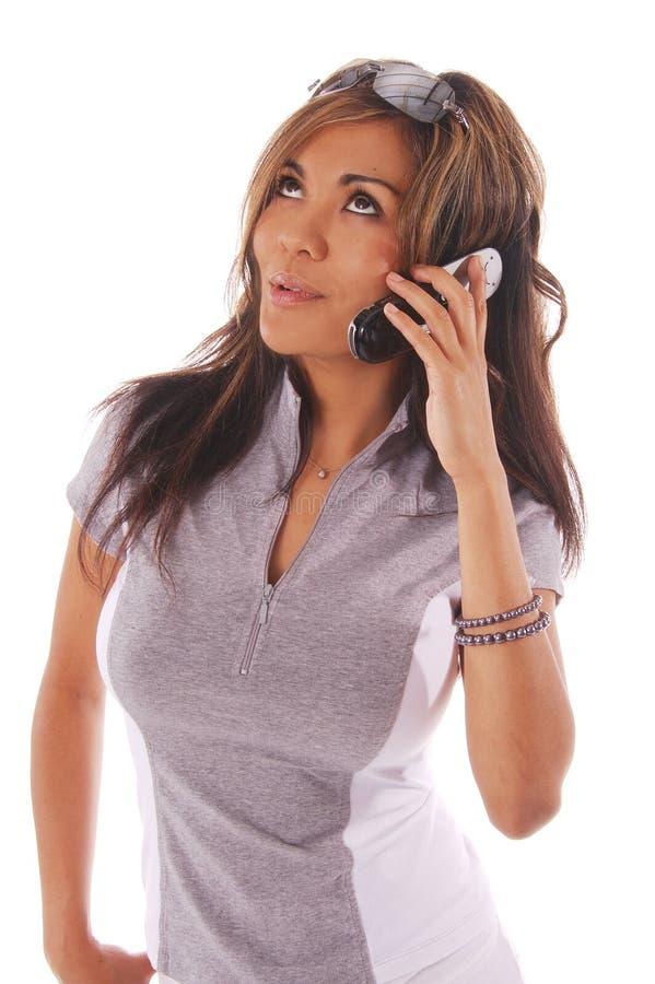 Telefone de pilha da mulher do exercício fotografia de stock