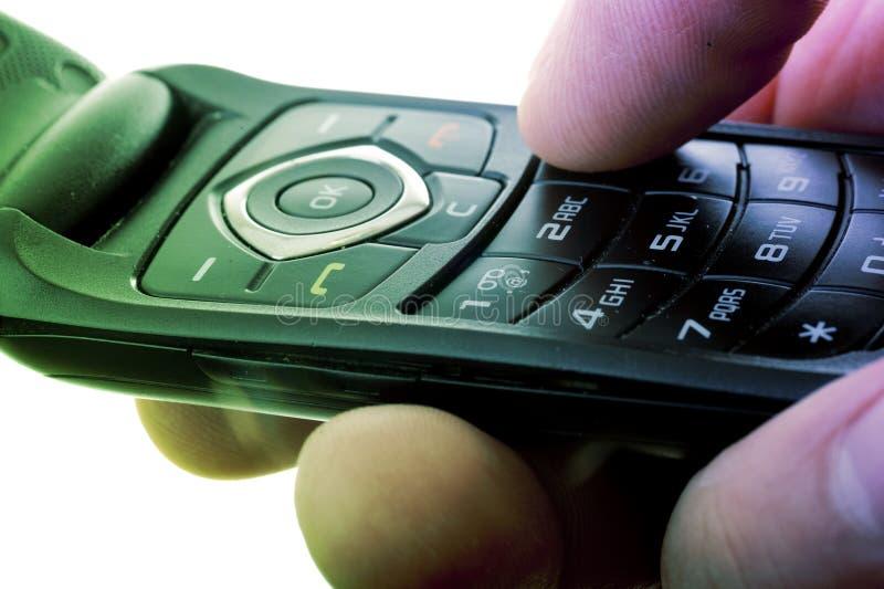Telefone de pilha em uma mão imagens de stock royalty free