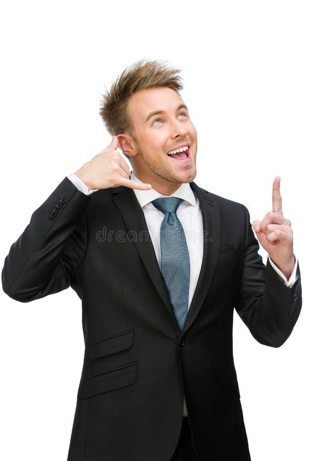 Telefone do homem de negócios que gesticula pontos com dedo foto de stock