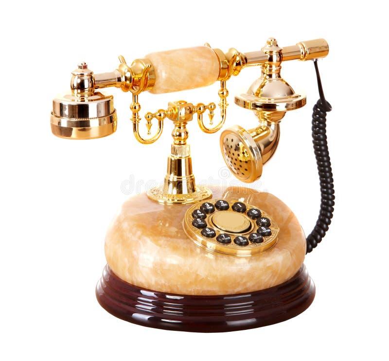 Telefone do ouro velho do onyx. fotos de stock
