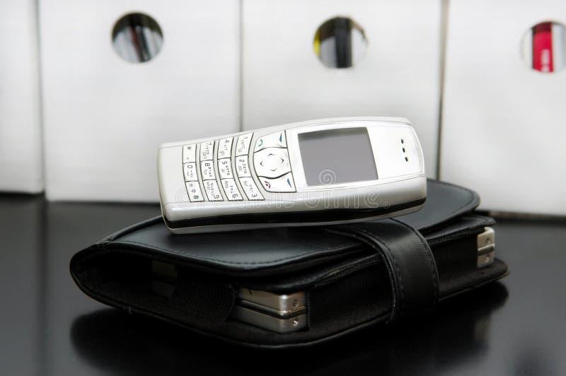 Telefone e organizador de pilha foto de stock
