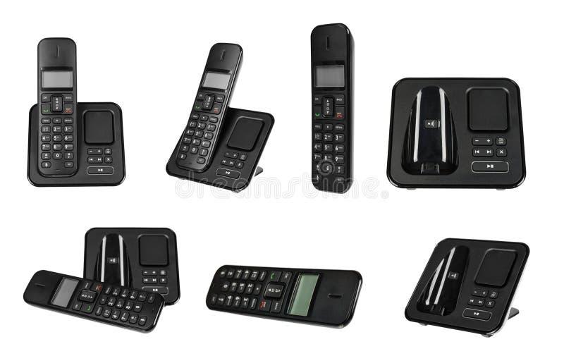 Telefone, grupo e coleção pretos do escritório Isolado fotografia de stock