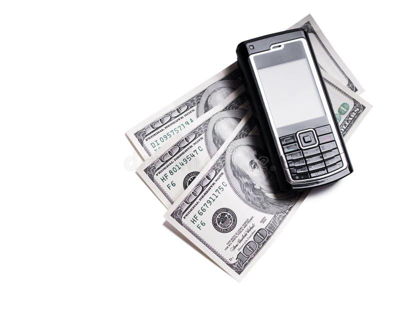 Telefone móvel e dólares fotografia de stock royalty free