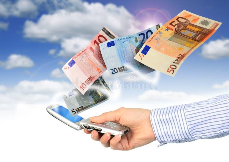 Telefone móvel e euro- dinheiro. fotos de stock royalty free