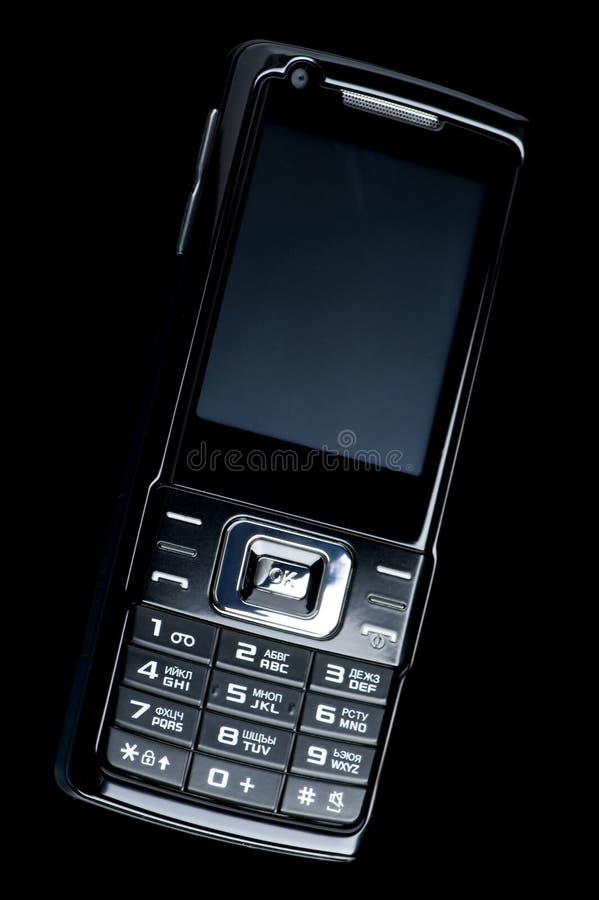 Telefone móvel no preto imagens de stock