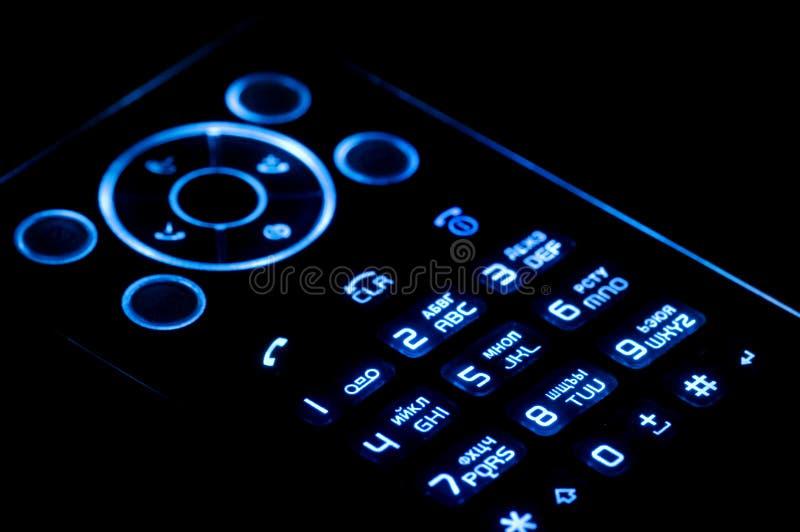 Telefone móvel no preto fotografia de stock
